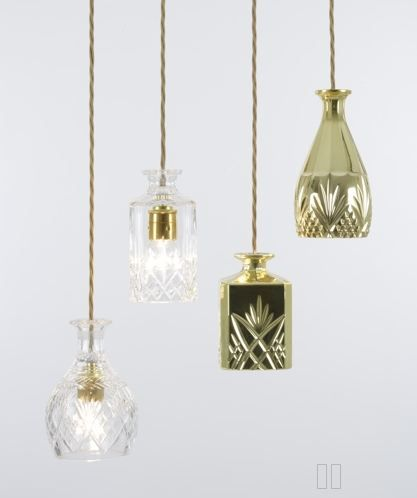 I did a big story, Put A Bulb In It, about all the great things that artisans are transforming into lighting. These are crystal carafes transformed into pendants by Lee Broom -- gorgeous!