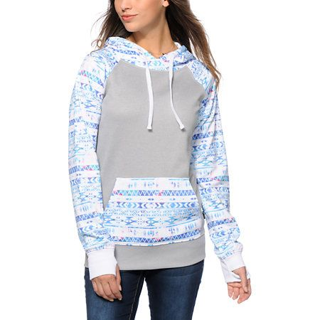 A cozy grey snow fleece hoodie is finished with a colorful tribal print hood, pocket and raglan sleeves for an on-trend look perfect for the mountain tops.
