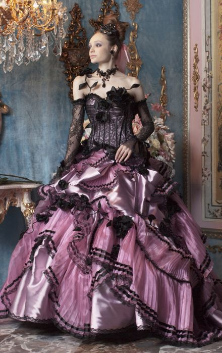 Its a little too wild west saloon girl for my tastes, but even if I don't find them beautiful, I pin almost every Stella dress I see, because I love the detail, the over the topness of each dress.  dball~dressballgown