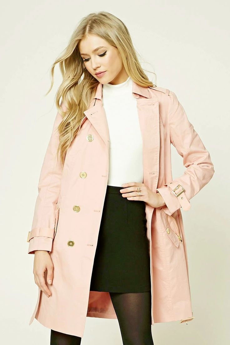 A woven trench coat featuring a notched lapel with a double-breasted front, two zippered flap pockets , long sleeves, a belted waist, vented back hem, and a longline silhouette.