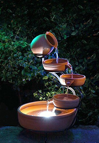 Small Solar Powered Water Feature in Terracotta. Jug and Bowls with LED light. Outdoor garden waterfall with a cascade effect. More like this at www.patiocascades.co.uk