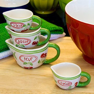 Cheery Cherries - Make a switch in the kitchen from cold-weather navy and burgundy to Spring's happy hues. Try dishtowels in Kelly green, mixing bowls in primary colors, or red-and-white-cherry measuring cups to cast out the winter blahs.