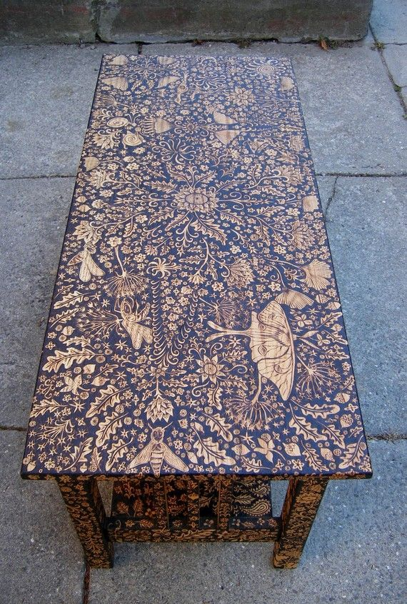 Fantastic WOOD BURNED FURNITURE ART  with Plant & Insect Details. Coffee Table by Cecilia Galluccio. http://www.trendir.com/wood-burned-coffee-table-and-chair-by-cecilia-galluccio/ . Many more  Detailed Art On Furniture Ideas - Bored Art