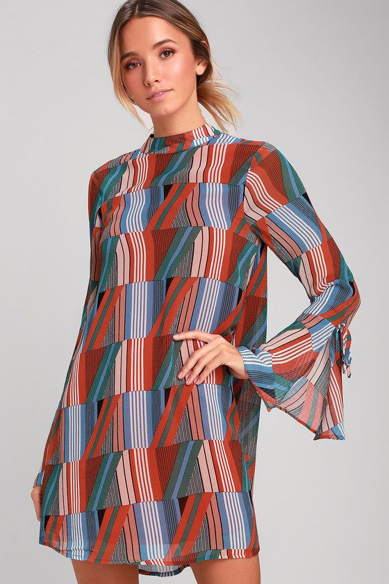 57a57348705b0f Get into the swing of things in the Lulus Meet You There Rust Orange Print  Flounce Sleeve Swing Dress! Lightweight woven poly in a retro rust orange,  light ...