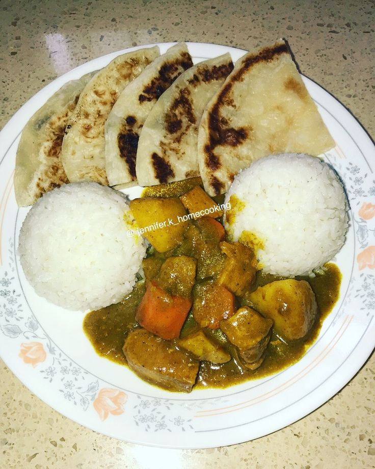 Curry chicken with rice and paratha bread
