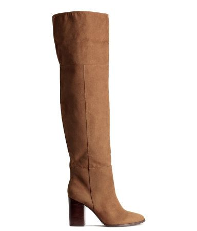 Knee-high boots in imitation suede. Soft leg section with slit at top. Rubber soles. Heel height 3 1/4 in.