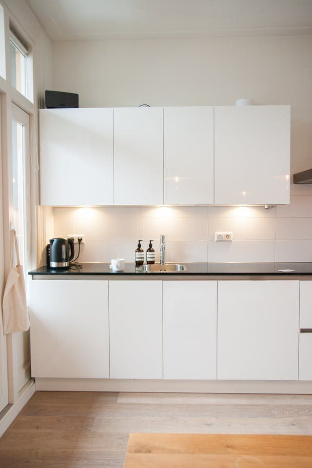 4 Ways To Add Lighting Under Your Cabinets For 35 Or Less Cheap Kitchen Cabinets Kitchen Renovation Kitchen Cabinets