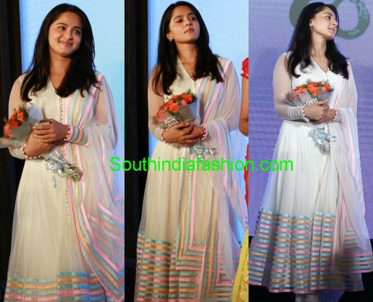 "Actress Anushka Shetty looking elegant in white net anarkali at ""Saivam"" movie audio launch event."