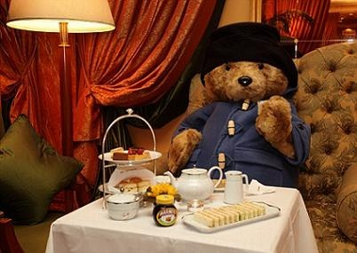 """""""Well, Paddington,"""" said Mr Brown, as he placed two steaming cups of tea on the table and a plate piled high with cakes. """"How's that to be going on with?"""" Paddington Bear is a classic British children's fictional character, the first story was written by Michael Bond and published on 13th October 1958."""