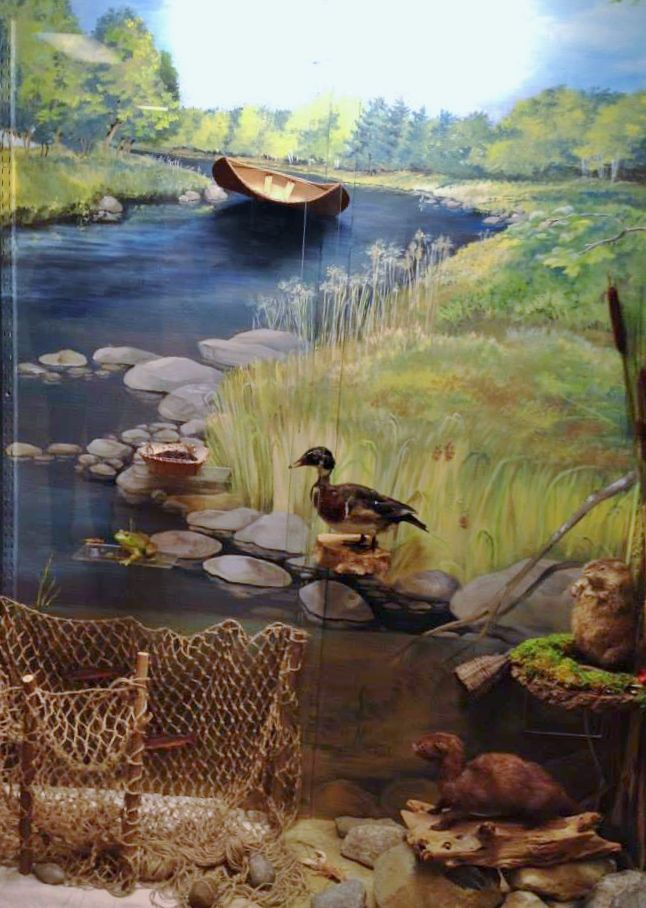 """""""Along the River"""" features a fishing weir by Vera Longtoe Sheehan and her son.  May through December 2014."""