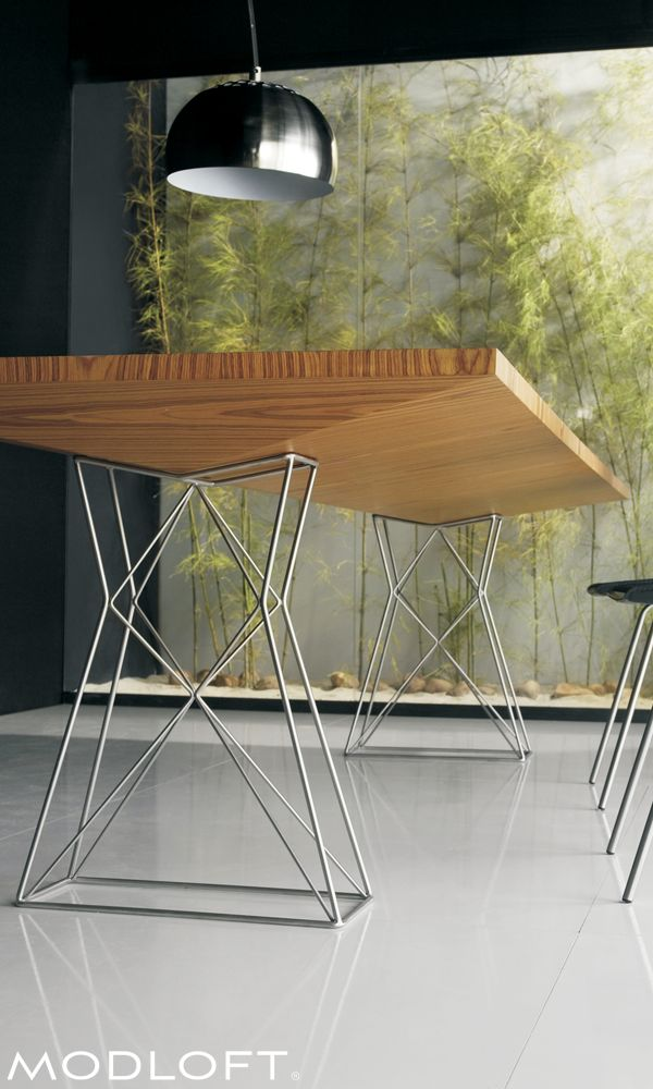 "Truly unique Modloft Curzon dining table, made with Brazilian teak veneer over stainless steel wiry legs. This piece turns heads. Two sizes (87"" & 102""). Available in our quick-ship program for immediate delivery."