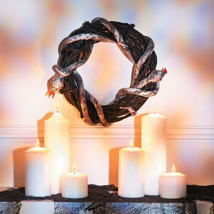 This wreath is a sleek and scaly Halloween decoration perfect for the porch, or hang it inside and creep out your Halloween party guests. Spooky, slithery and . Halloween Decorations, Halloween Party, Christmas Decorations, Holiday Decor, Christmas Yard, Xmas, Snake Party, Oriental Trading, Party Guests