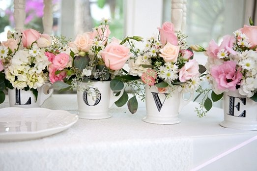 beautiful decor for an engagement party, bridal shower or even a wedding :). Love this!  Use bright red flowers pots, burlap and cut out letters with black vinyl