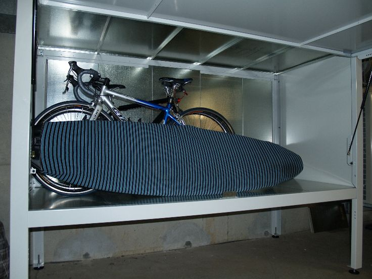 This clever storage box fits a bike and a surfboard! #storagebox