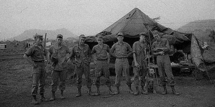 CTT#3 at the 4th Infantry Division Base Camp in Pleiku, RVN. The photo was taken in 1967. From L to R are: 1LT Myrick (formerly SF), E-4 Hillard, E-4 Simpson, E-3 Seever, E-3 Lumsden, E-4 Snitgen with Goldie, and E-3 McIntosh. They were the remaining members of the original ten man Team.