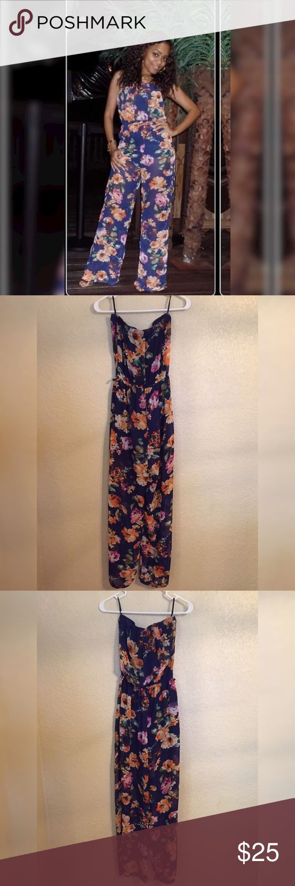 """Beautiful Floral Jumper In good condition! Only worn twice! Has one flaw....a tear in the crotch area (please see last photo). You can sew it to fix it. Length of jumpsuit is 53.5"""". Length from crotch to bottom is 30"""". Love Culture Pants Jumpsuits & Rompers"""