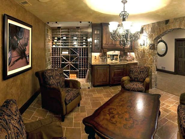 Sophisticated Wine Cellar    Old World-inspired furniture, stonework and lighting combine to create an elegant wine cellar and tasting area. The floor-to-ceiling glass doors of the wine cellar bring a contemporary touch to the space and allows for the area to be kept cool.