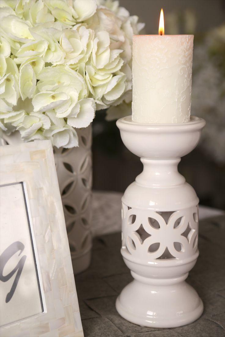 White ceramic frangipani/plumeria candelabra.