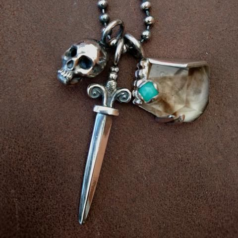 African Voodoo - Heidi Liebenberg ~ custom necklace on heavy ball link chain. Hand-carved charms and setting with smokey quartz and chrysoprase.