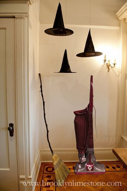 floating witches hats hung with fishing line along with a broomgood idea for a front porch for halloween - Homemade Halloween Party Decorations