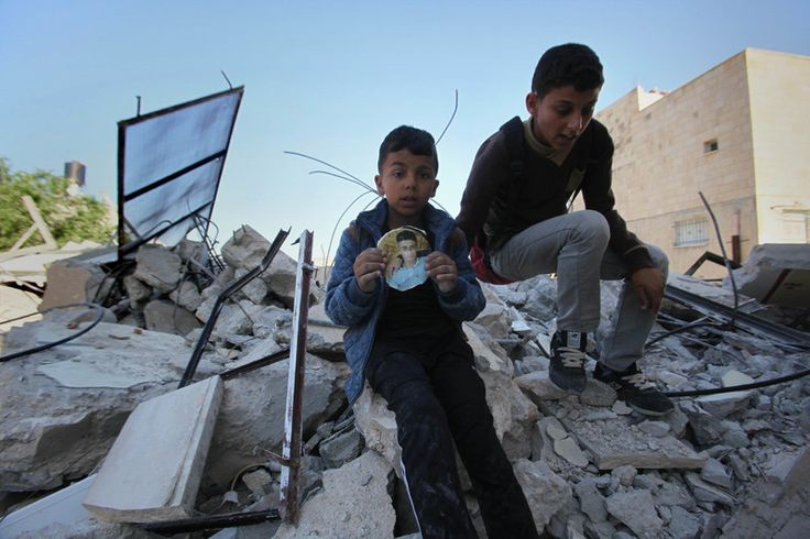 Charlotte Silver Rights and Accountability 7 April 2016 Palestinians boys sit on the rubble of their family home. It was one of three houses destroyed by Israeli occupation forces in Qabatiya villa… http://winstonclose.me/2016/04/08/israel-aims-to-save-souls-by-making-palestinians-homeless-written-by-charlotte-silver/