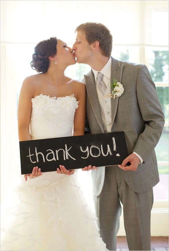 I like the idea of having a picture from the big day with a thank you sign. I think it would be a good idea to make that into a postcard to send thank you notes to people. I have a lil chalkboard we could do this with