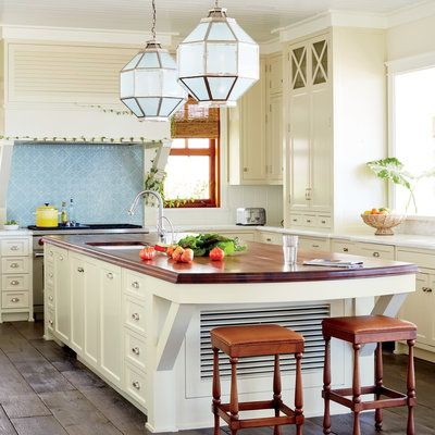 A Beautiful Family Friendly Beach House Kitchen With White Cabinets, A  Light Blue Backsplash