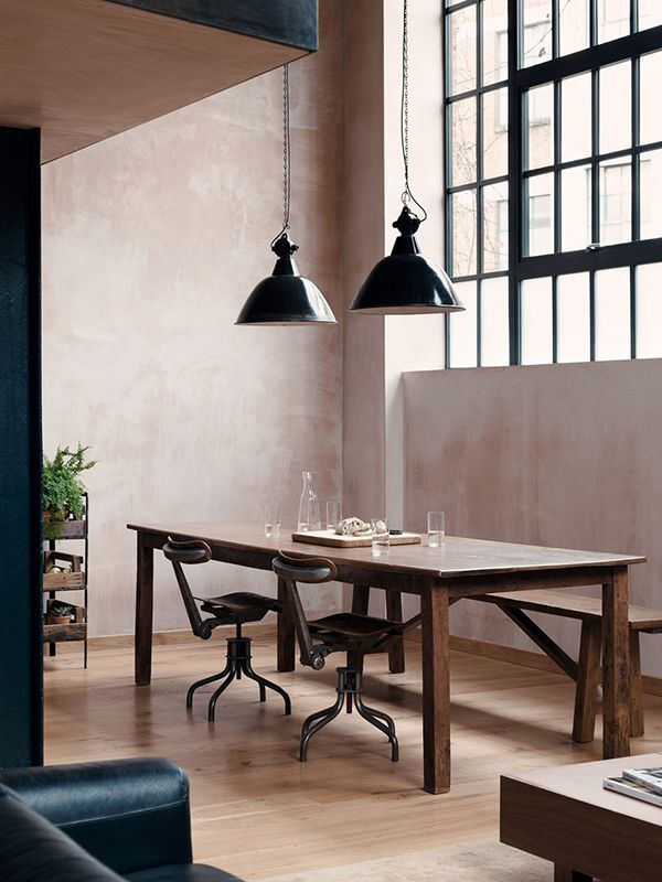Simple black and beige kitchen / dining area. A welcoming mix of natural and modern elements.  Blood & Champagne