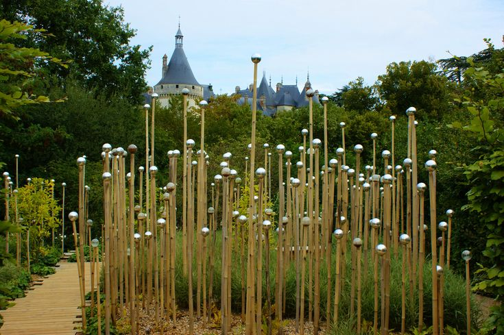 Contemporary Garden with silver spheres on bamboo stakes | Flickr - Photo Sharing!