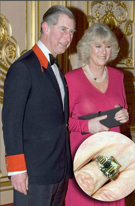 A ring of great historic value, Camilla's heirloom engagement ring was left to Charles by his grandmother, Queen Elizabeth (a gift from her mother-in-law upon the birth of Queen Elizabeth II). An art deco design, the platinum ring is comprised of an emerald-cut diamond flanked by three diamond baguettes on both sides.