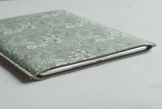 https://www.etsy.com/listing/185580687/padded-sleeve-case-ipad-mini-kindle?ref=related-1 Padded sleeve (case): iPad Mini / Kindle Touch / Kindle 6/ Nook / Pocketbook case and custom-made e-reader & tab cases. This case was handmade using cotton in green and yellow floral pattern as the mail fabric and plain khaki cotton as lining. Photos: Bunny Street, Irene Sheyko