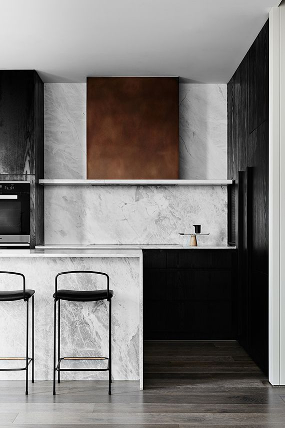 Open kitchen, marble island | Hampton Penthouse. Interior design by Huntly, photo by Brooke Holm