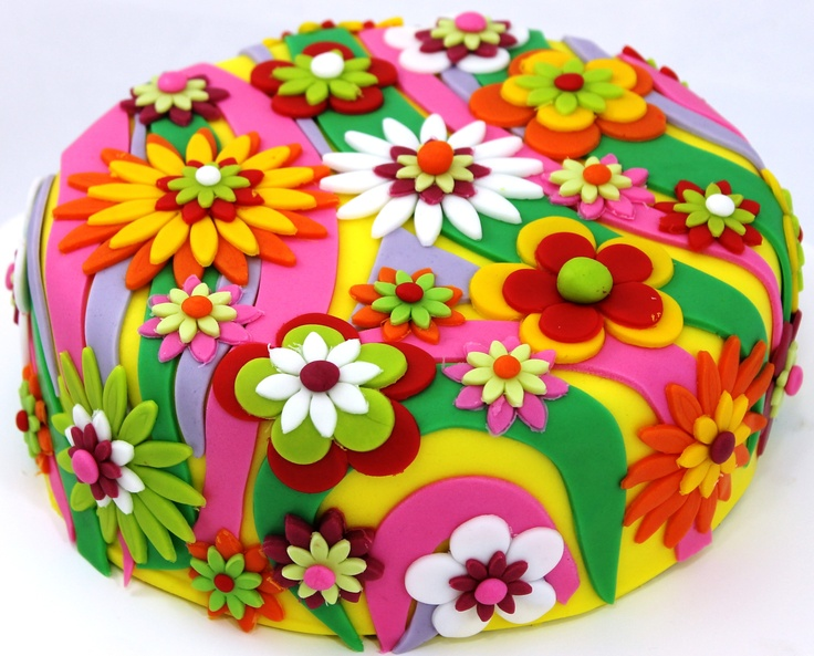 groovy flower power cake I think this cake would be perfect for my little girl ehm she will be 12 soon so not little anymore haha but I am positive she would love that one !!!