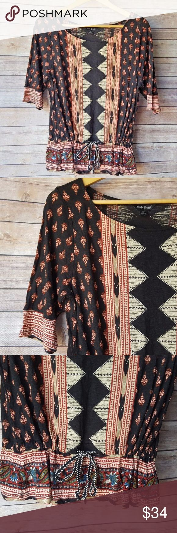 """Lucky Brand Womens Black Boho Aztec Tribal Top Lucky Brand Womens Black Boho Aztec Tribal Floral Cinched 3/4 Sleeve Size Medium   Excellent used condition- no rips, stains, smoke free home. Pit to pit: 18"""" Shoulder to hem: 24"""" Lucky Brand Tops Blouses"""