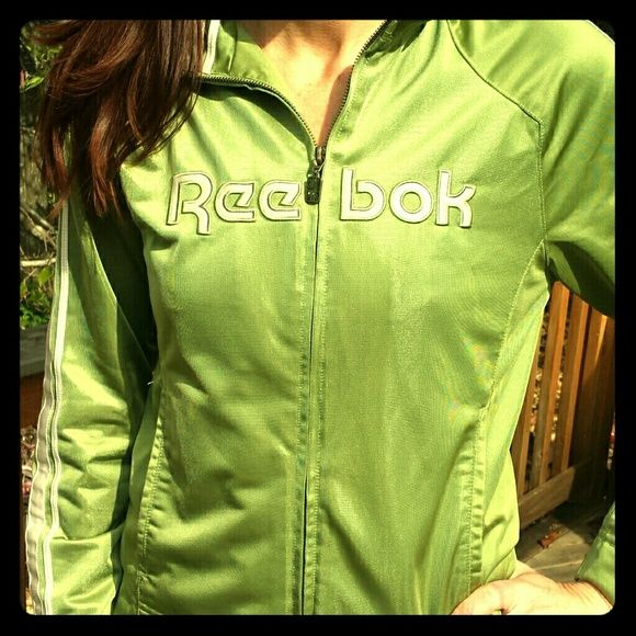 "Reebok green track suit jacket Get your fitness vibe on! Reebok classic size medium lime green satin jacket. Super soft, super stylish! Minor spot on pocket and one pull in thread in front. Can hardly see but want to be honest! (Look under the ""e"") Worn and loved but a steal at this price! Reebok Jackets & Coats"