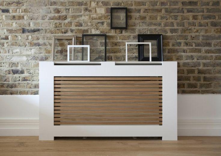 cache radiateur design en blanc et marron, et mur en fausses briques