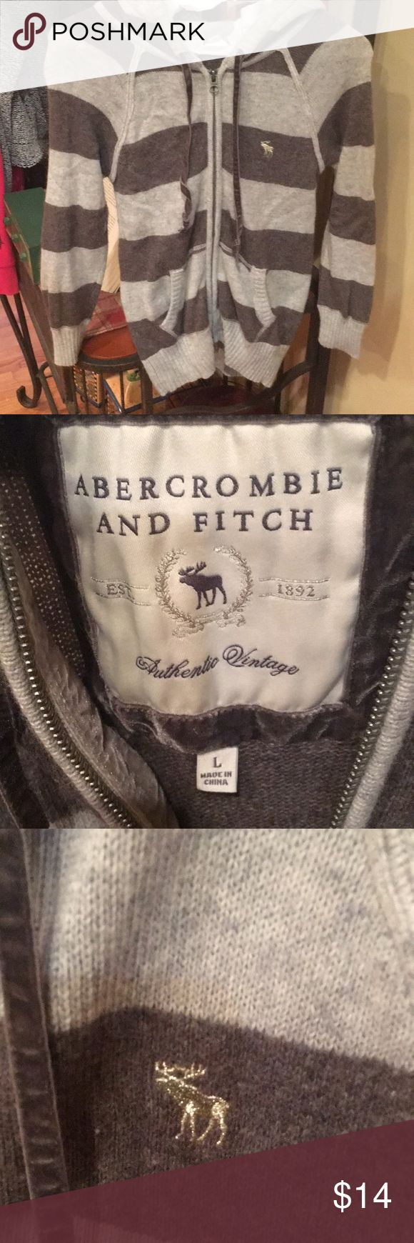 Women's Abercrombie and Fitch hoodie Abercrombie and Fitch hoodie size large good condition. Brown and oatmeal color Abercrombie & Fitch Tops Sweatshirts & Hoodies