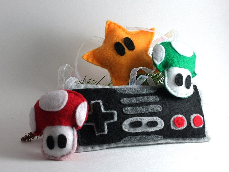 Super Mario Bros. Christmas Tree Ornament Set. $25.50, via Etsy. I could make these out of felt.