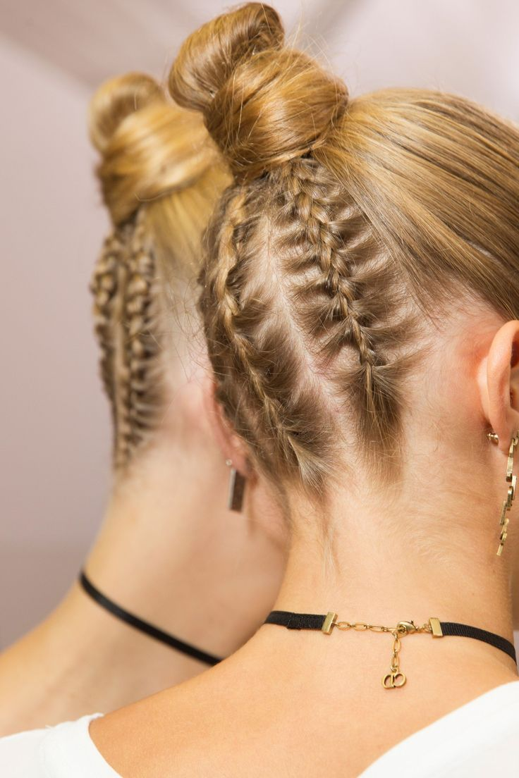 Christian Dior - Guido Palau styled hair in skater-style buns, with four plaits running from the nape of the neck to the bun.