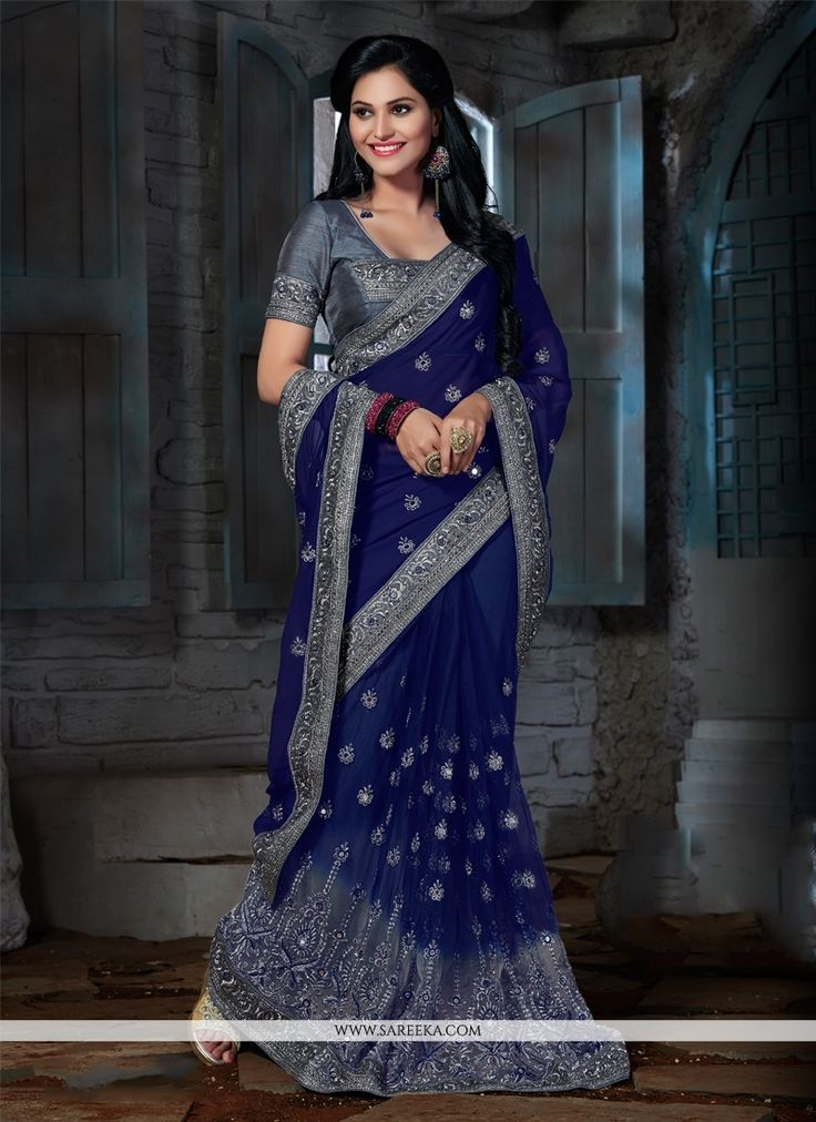 Include yourself of the glamour of the season with this elegant navy blue faux chiffon and net designer saree. This desirable dress is showing some great embroidery done with embroidered and patch bor...