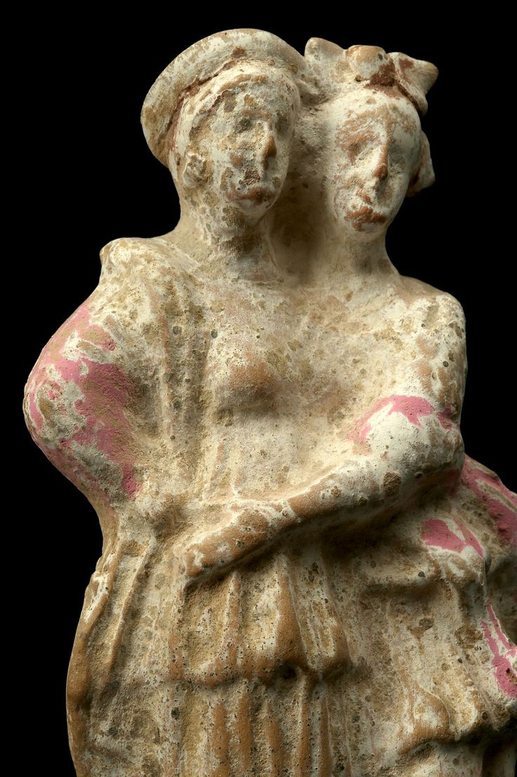 Tanagra terracotta figurine, Canosa, 3rd century B.C. Tanagra terracotta figurine, Canosa terracotta figure, showing two female figures embracing, both wearing a long chiton and himation, with remains of pink pigment, 16 cm high. Private collection