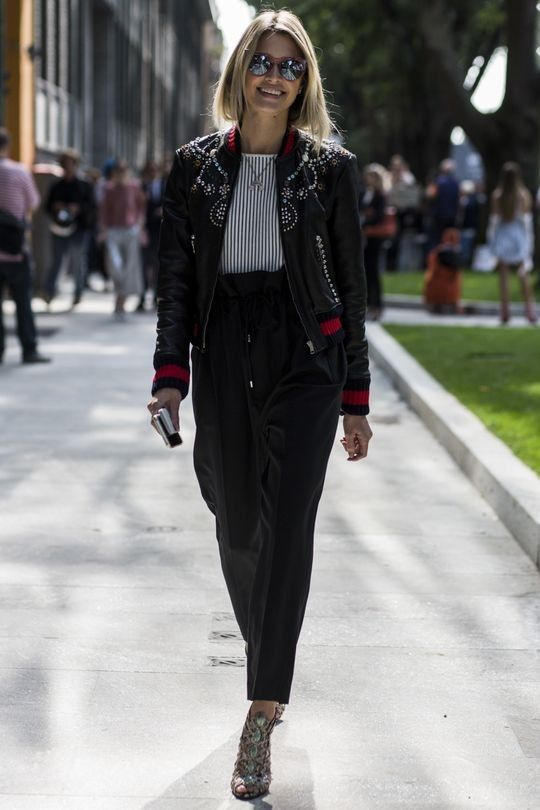 wearing a bomber jacket - street style - Vogue Australia