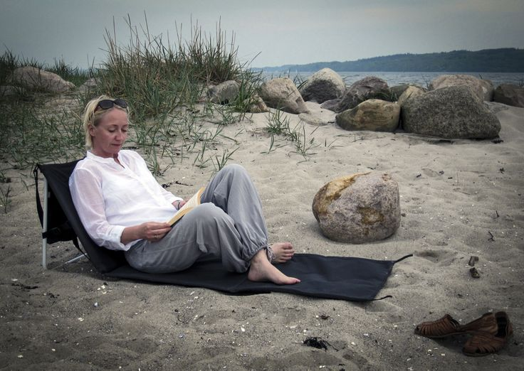 A quiet moment with a book and the Isabella beach mat