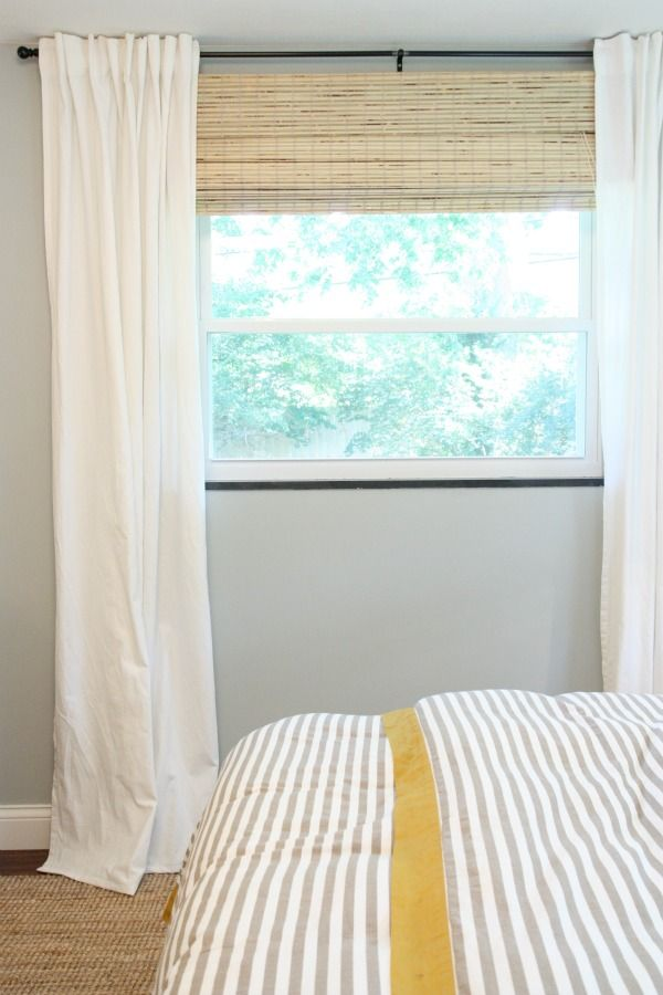 living room window ikea curtains high and wide bamboo blinds just below the curtain rod room darkening shade hidden underneath at the top of the