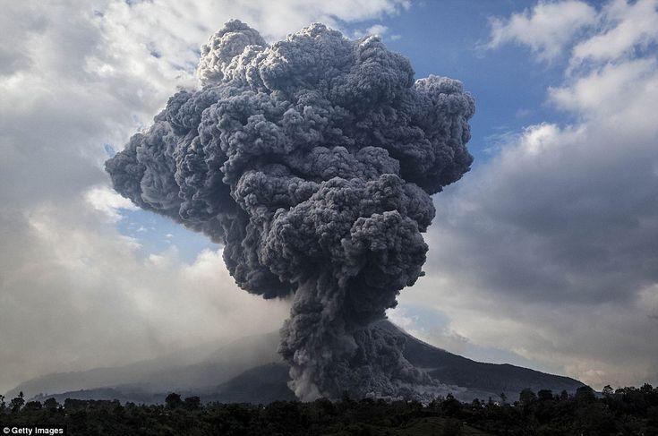 Mount Sinabung spews pyroclastic smoke, seen from Tiga Pancur village in Berastagi, Karo ...