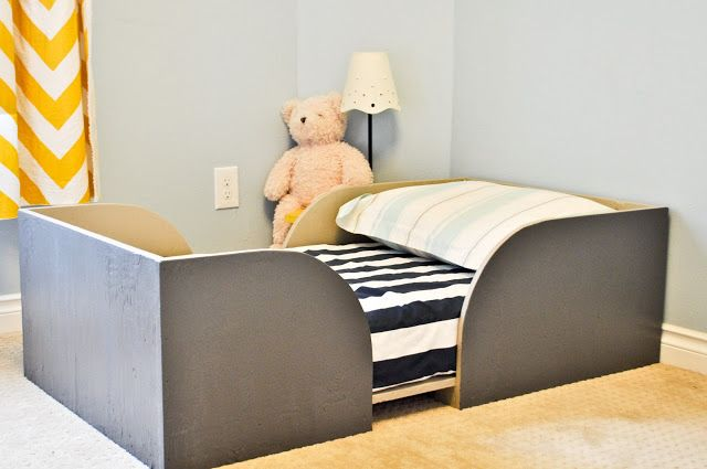 Toddler Bed DIY...I wouldn't be able to make this without visiting a wood shop, but it's an elegant solution for active sleepers!