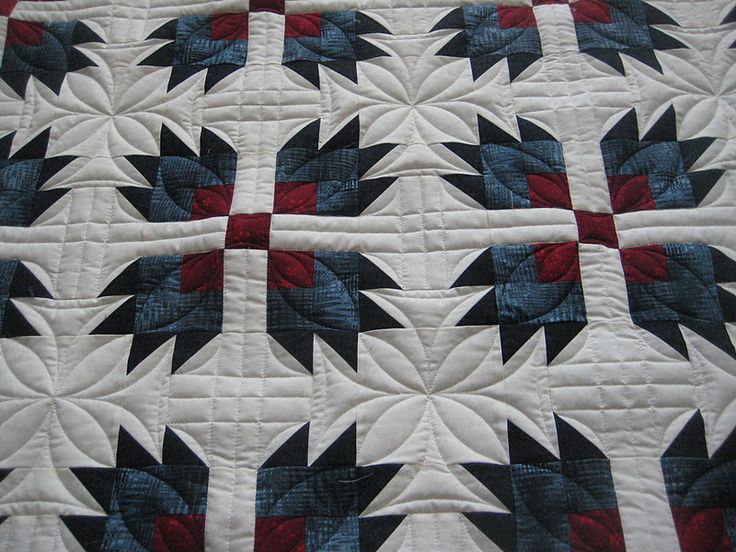 Nice quilting for a bear paw quilt.