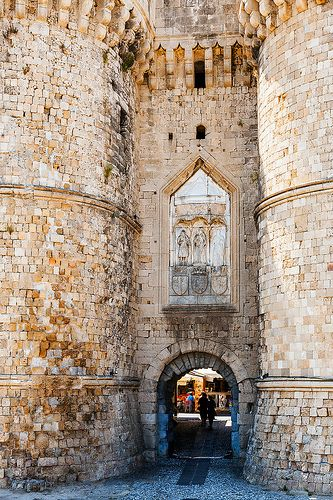 Fortified entrance to the old town of Rhodes, a Greek island with a rich history.