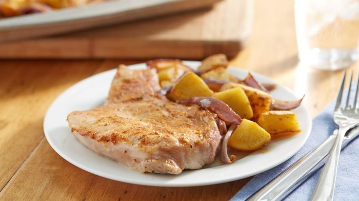Flavored with rosemary and seasoned salt, Dijon mustard becomes a zesty basting sauce for Yukon gold potatoes and bone-in pork chops.