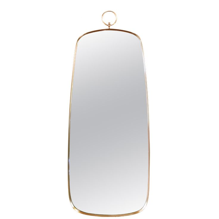 Elegant Brass Framed Mirror in the Manner of Fornasetti  USA  1960's  Elegant wall mirror surrounded by a beautiful brass frame and hanging ring The mirror hangs from a wire on the back to the ring is free to float and be purely decorative.